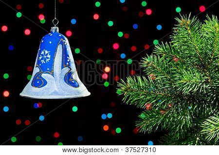 New Year decorations bell on dark multicolor circles bokeh background