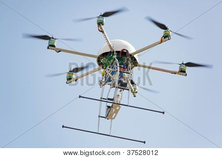 uav drone hexarotor flying in blue sky