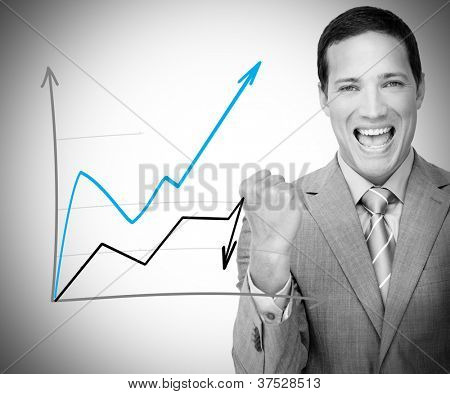 Businessman standing behind blue and black graph cheering