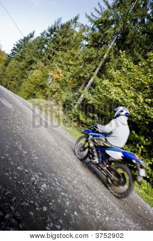Motocross Rider Driving Through Forest