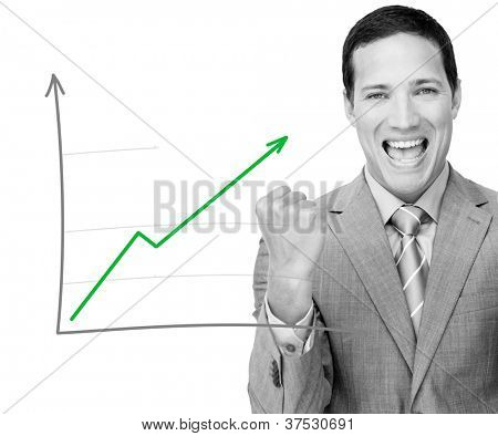 Business man celebrating behind graph