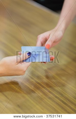 Credit card transaction between two women