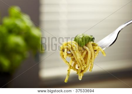 Fork with spaghetti pasta pesto