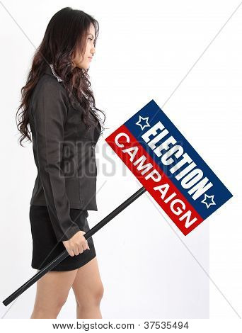 Business Woman Holding Election Sign