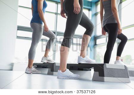 Three women in aerobics class in gym
