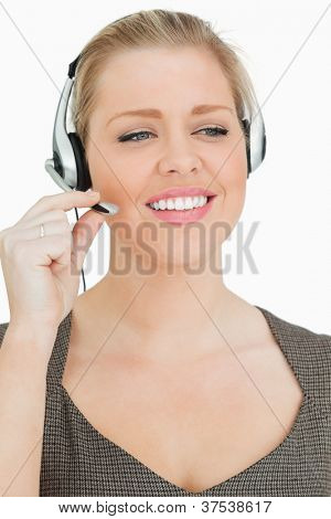 Pretty woman working in a call center against white background