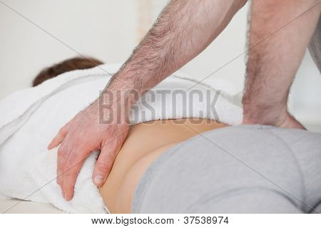 Close-up of a physiotherapist massaging a back in a physio room