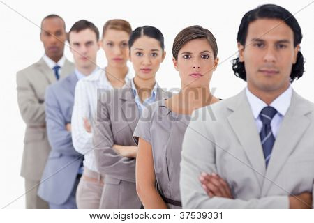 Big close-up of determined colleagues in a single line with focus on the first woman