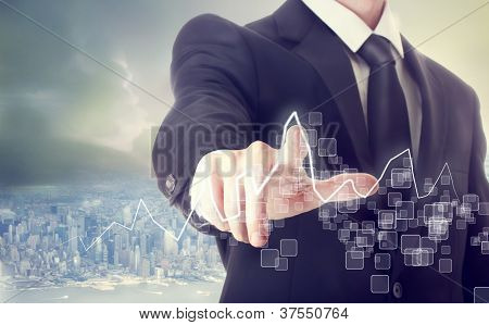 Businessman Touching A Graph