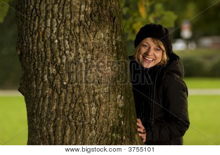 Gril Hiding Behind Tree