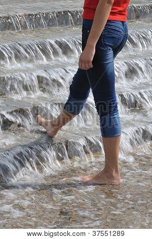 Svelte Woman's Legs In Water Cascade