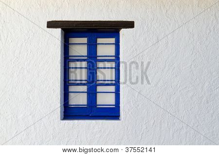 Blue Painted Window Frame In White Structured Wall