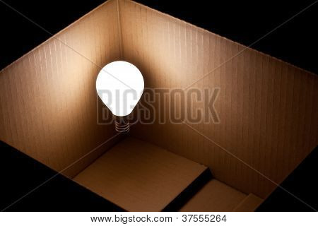 Bright lightbulb floating in a box