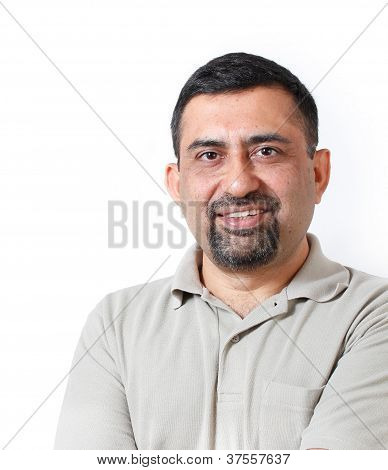 Handsome And Happy Middle Aged Mature Indian Adult Business Man Looking With Satisfaction And Happin