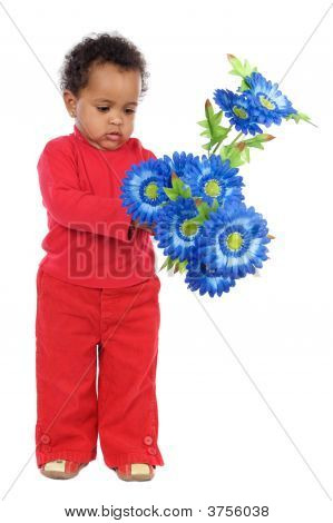 Adorable And Beautiful African Baby With Flowers