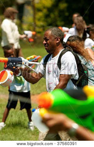 People Squirt Each Other In Huge Water Gun Fight