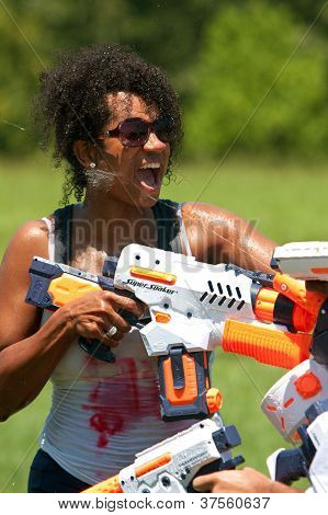 Woman Gets Squirted In Face With Water Gun