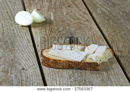 Bitten Piece Of Bread With White Lard