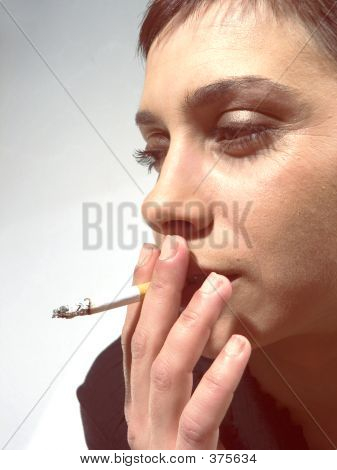 Close-up Of Woman Face With Cigarette