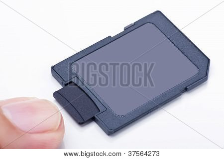 Black Front Side Micro Sd Memory Card Inserts Into Sd Card Adapter With One Finger