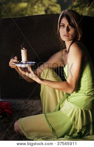 Woman With Candle In Graveyard