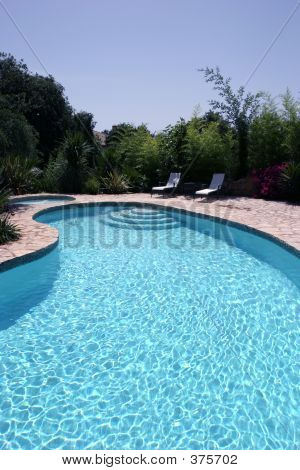 Big Sunny Swimming Pool In Spain