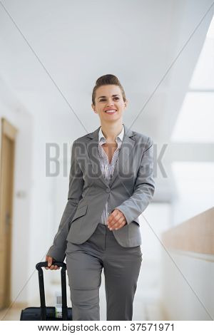 Business Woman In Business Trip Walking With Wheel Bag
