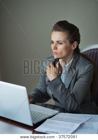Thoughtful Business Woman Working At Hotel Room
