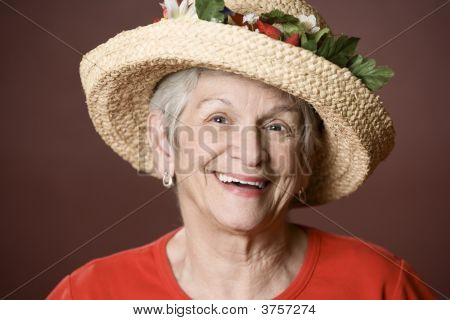 Senior Woman In A Straw Hat