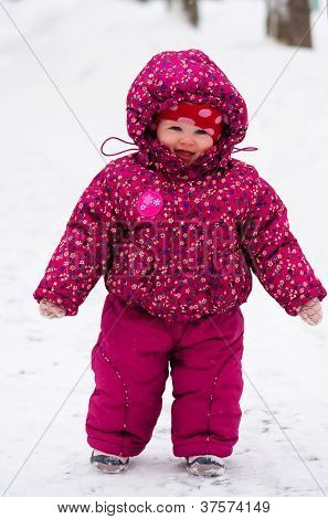 baby walk by snow near winter park