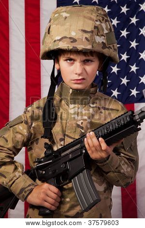 Boy Usa Soldier In Front Of American Flag With Rifle