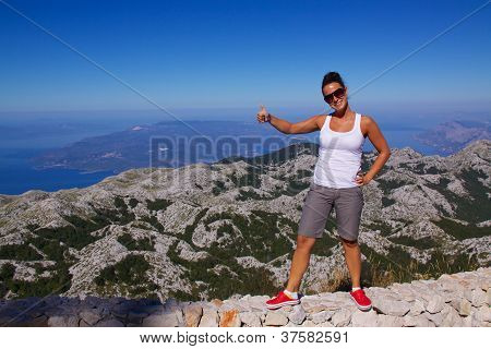 Smiling Girl On Hilltop