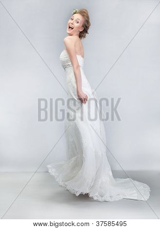 Dancing Cheerful Bride In Long Wedding White Dress