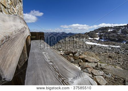 Wooden resting bench in the italian alps