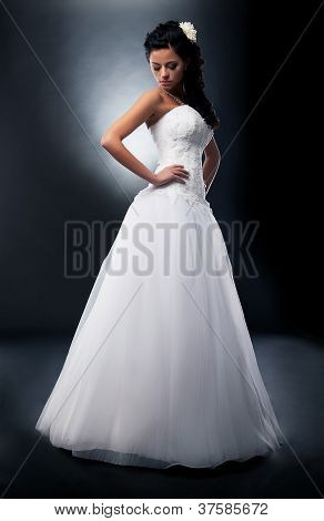 Beautiful Bride Brunette In Wedding White Dress On Podium