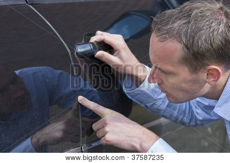 Man Checking His Car.