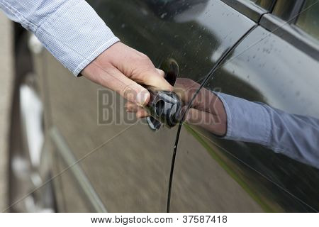 Man's Hand Unlocking Car Door.