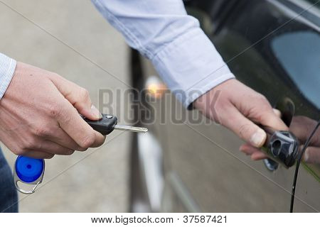 Man Unlocking Car Door.