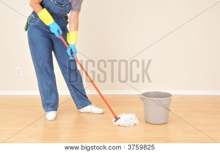 Woman In Overalls Mopping