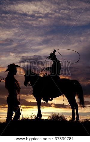 Cowboy On Horse Swinging Rope