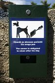 image of pooper  - Plastic bag dispenser for dog poo in park - JPG