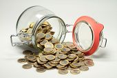 picture of economizer  - From a jar euro coins are distributed - JPG