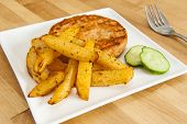 foto of rutabaga  - Salmon burger with rutabaga fries and cuccumbers - JPG