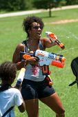Woman Squirts Other People In Water Gun Fight