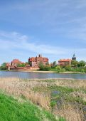 stock photo of polonia  - View over the Nogat River to Malbork Castle - JPG