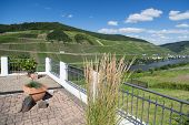 stock photo of moselle  - Terrace with beautiful view at the river Moselle in Germany - JPG