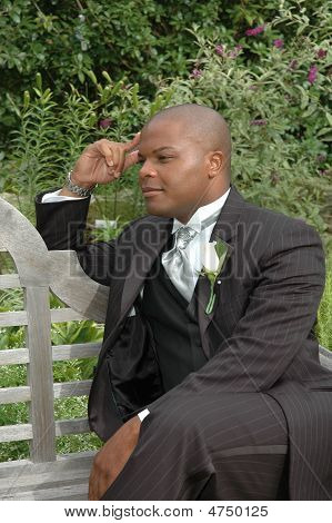 Groom Waiting on a Bench