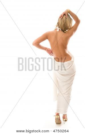Sexy Young Woman Standing With A Bare Back.