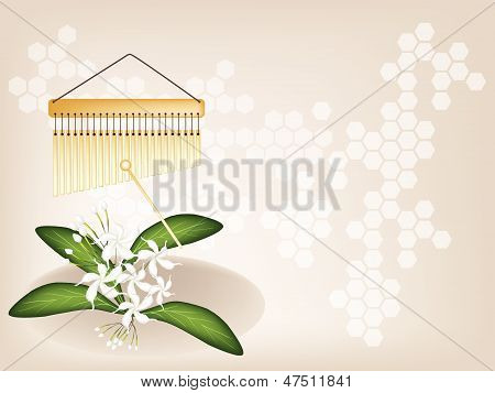 A Musical Bar Chimes And Jasmine On Brown Background