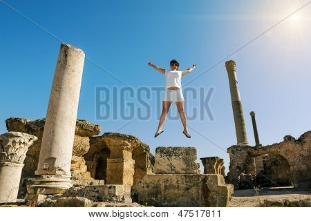 Girl In Jump Amid The Ruins Of Carthage In Tunisia